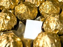 Golden chocolates space. Royalty Free Stock Photo
