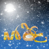 Golden chrismas ball in snow at night Stock Photo
