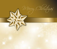 Golden  Christmas abstract background - card. Golden ribbon with bow and Christmas abstract background Royalty Free Stock Photo