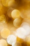 Golden Christmas background. Golden Christmas ornament shot out of focus Stock Photography