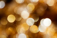 Golden Christmas background. Golden Christmas ornament shot out of focus Stock Photos