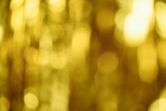 Golden christmas christmas background. Abstract shiny background out of focus. Christmas tinsel is out of focus