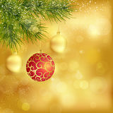 Golden Christmas background with baubles and fir twigs. Festive traditional golden Christmas background with hanging baubles, blurry lights and fir twigs for the Stock Photography