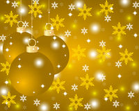 Golden Christmas background with Christmas balls. And snowflakes Stock Images