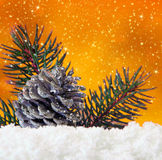 Golden christmas background and fir cones. Royalty Free Stock Photos