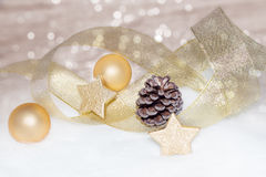 Golden Christmas background with gold baubles, balls Royalty Free Stock Image