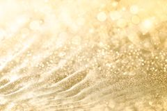 Golden Christmas background with sparkling and twinkling bokeh from party lights and golden glitter, full frame copyspace for your royalty free stock photography