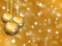 Golden Christmas background with stars and balls Stock Images
