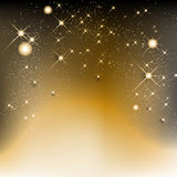Golden christmas background with stars and shines Stock Image