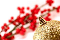 Golden Christmas ball. Close up, berry background Royalty Free Stock Photos