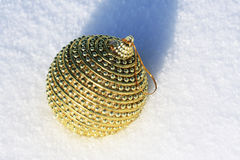 Golden christmas ball. In snow Royalty Free Stock Images