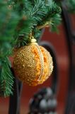 Golden Christmas ball. Picture of golden Christmas ball and green sprays, hand made Stock Image