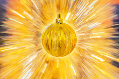 Golden Christmas ball on abstract background Stock Photos