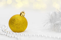 Golden Christmas ball with beads Royalty Free Stock Photo