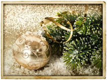 Golden christmas ball with christmas tree branch Stock Images