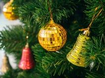 Golden christmas ball on christmas tree Royalty Free Stock Images