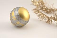 Christmas decoration. Golden ball. Golden Christmas ball decoration soft white background Royalty Free Stock Photo