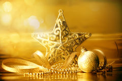 Golden christmas ball decorations for celebration background Stock Photo
