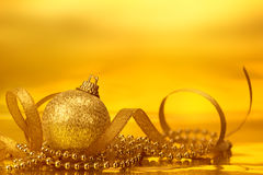 Golden christmas ball decorations for celebration background Royalty Free Stock Photos