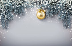 Golden Christmas ball  on gray background. Stock Images
