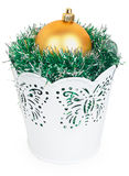 Golden Christmas ball and the green garland in decorative white Stock Images