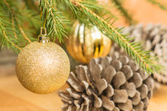 Golden Christmas ball on green spruce branch Royalty Free Stock Photography