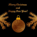 Golden Christmas ball on a greeting card . Royalty Free Stock Photo