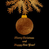 Golden Christmas ball on a greeting card . Royalty Free Stock Images