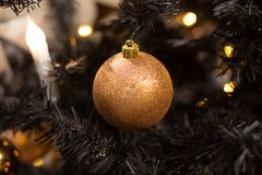 Golden Christmas ball hanging on the tree, beautiful decoration Stock Photography