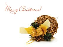Golden Christmas ball made of willow on the white Stock Photos