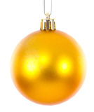 Golden christmas ball ornament brightened Stock Image