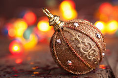 Golden christmas ball over blurred colorful backgr Royalty Free Stock Image