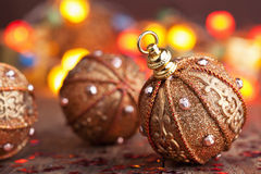 Golden christmas ball over blurred colorful background Royalty Free Stock Photo