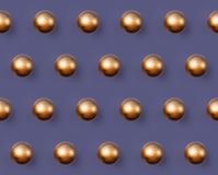 Golden Christmas ball pattern on violet background royalty free stock image