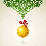 Golden Christmas ball with ribbons and green ornaments. Royalty Free Stock Photos