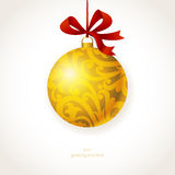 Golden Christmas ball with ribbons and place for text. Stock Image