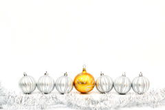 Golden christmas ball and silver balls. In row stock photography