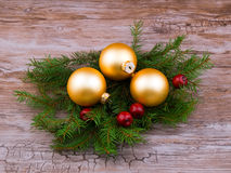 Golden christmas ball with spruce branch Stock Photo