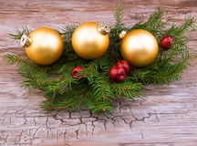 Golden christmas ball with spruce branch Royalty Free Stock Photography
