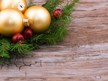 Golden christmas ball with spruce branch Royalty Free Stock Images