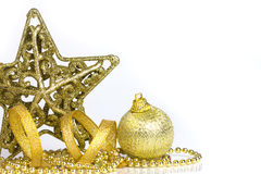 Golden christmas ball and star decorations on white background Royalty Free Stock Photo
