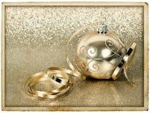 Golden christmas ball with streamer. vintage card Stock Photos