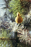 Golden Christmas ball and synthetic spruce branch Royalty Free Stock Photo