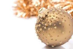 Golden Christmas ball and tinsel,  Stock Photos