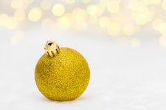 Golden Christmas ball on white Royalty Free Stock Image