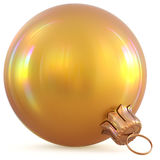 Golden Christmas ball yellow gold New Years Eve decoration. Bauble wintertime adornment souvenir. Traditional hanging ornament happy winter holidays Happy Merry Stock Photo