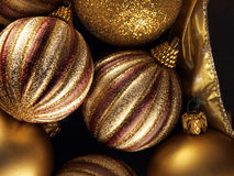 Golden christmas balls. Beautiful golden christmas balls close-up stock image