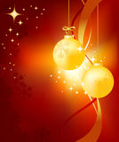Golden Christmas Balls. On a background with snowflakes Royalty Free Stock Photo