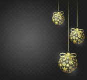 Golden Christmas balls. On a background with snowflakes Stock Image