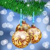 Golden Christmas Balls. The Realistic Christmas Balls on fir branches Royalty Free Stock Photos